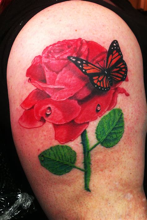 butterfly rose tattoo from best ink chicago ink piercing and microdermals