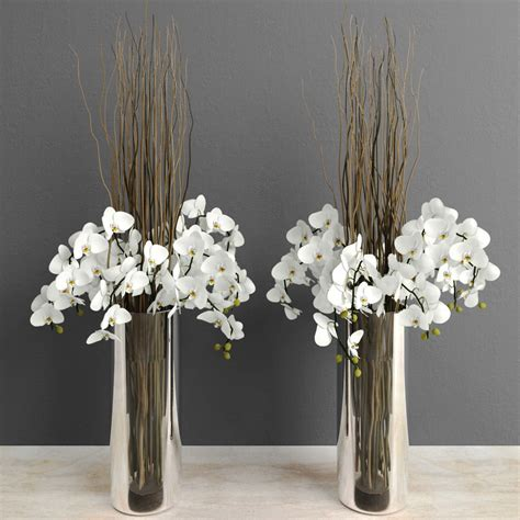 white orchids with willow branches in glass vase 3d