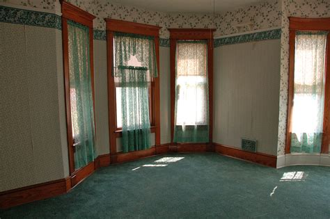 decorating around a forest green carpet that is a forest green and it extends the