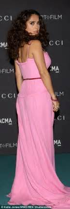 Light Pink Jumpsuit by Kim Kardashian Showcases Her Bump In Jumpsuit At Lacma