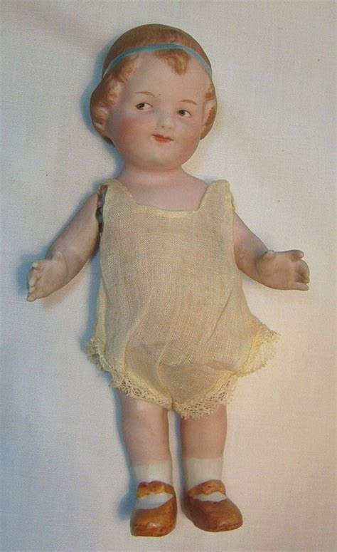 what is a bisque doll gebruder heubach german all bisque character coquette doll