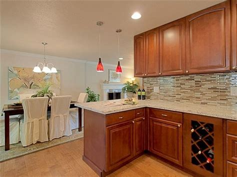 cognac kitchen cabinets maple cognac wood kitchen cabinets with wood looking tile
