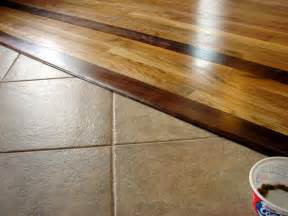 how do you handle transition from hardwood to cut tile