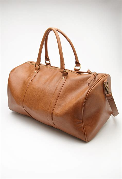 The Bag For The Who Is Doing The Gardener by Lyst Forever 21 Faux Leather Duffle Bag In Brown