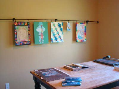 hang art made of metal how to use curtain rods to hang art