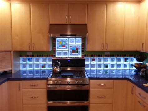 kitchen backsplash with glass tile blocks for light