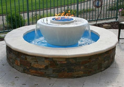 beautiful traditional outdoor patio water feature with gas