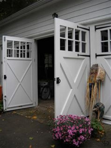 Garage Doors That Swing Open by 1000 Ideas About Carriage Doors On Garage
