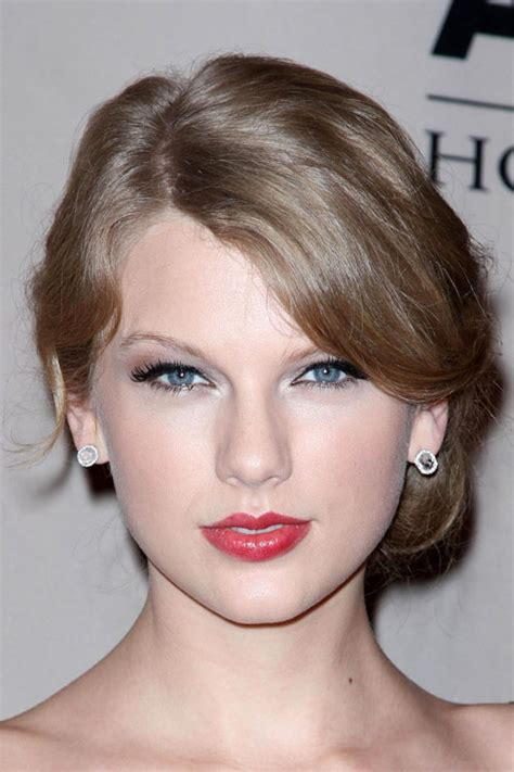 taylor swift ash dark blonde hair taylor swift wavy ash blonde updo hairstyle steal her style