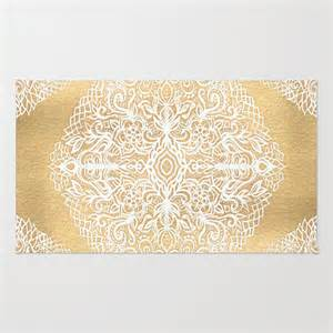 white gouache doodle on gold paint rug by micklyn society6