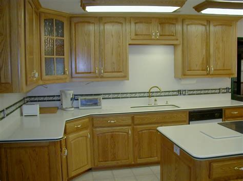 kitchen cabinets with light countertops white wood kitchen cabinets