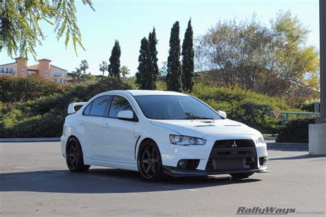 lancer evo white sports car research mitsubishi evo x vs corvette vs