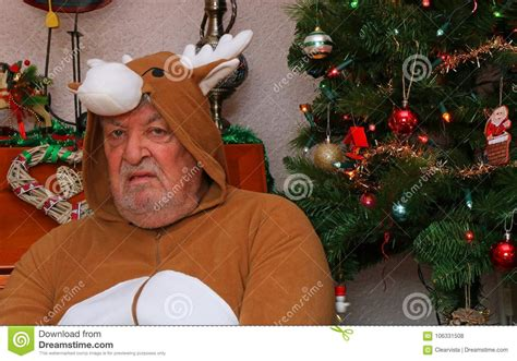 christmas present for grumpy old man miserable grumpy at stock photo image of grumpy elderly 106331508