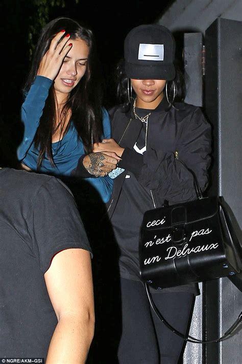 Rhianna Fashionweek With The Botkier Gladiator Bag by Rihanna Walks Arm In Arm With Lima As They Enjoy