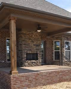 Acme Bedroom Furniture exterior stone fireplace and cedar posts contemporary