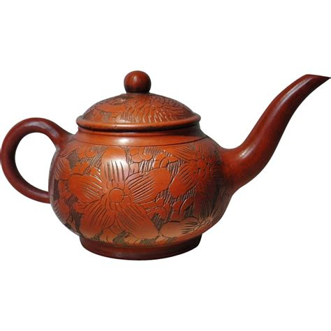 decorative yixing tea pot with floral design sold on ruby