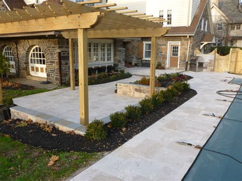 a backyard outdoor kitchen patio renovation you will love