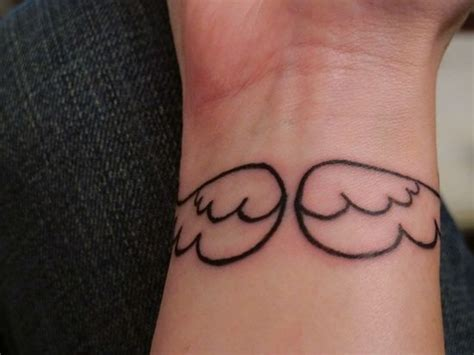 small angel tattoos for men best 25 small wing tattoos ideas on