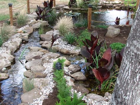 how to create a pond and stream for an outdoor waterfall stream and bog for koi pond goproponds the pond doctor