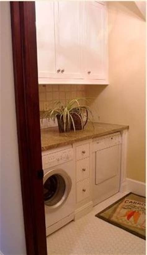 narrow cabinet between washer and dryer 1000 images about laundry room ideas on