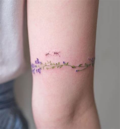 delicate tattoo delicate flower arm cuff with two ants flower