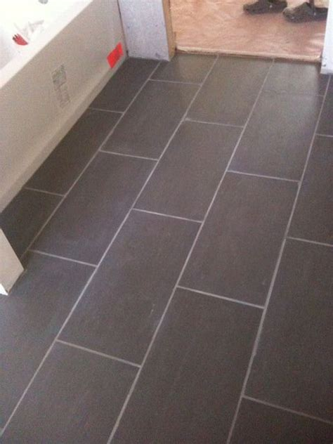 bathroom floor tile patterns 12x24 subway laid tile perhaps not this color but similar look this is probably what we re