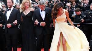 George clooney s wife amal has an oops moment on cannes red carpet