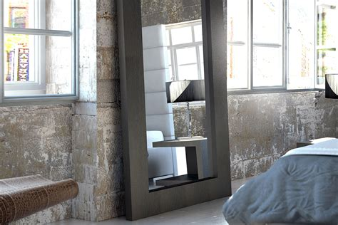 urban style bedroom design with rectangular espresso framed mirror and oversized floor mirrors