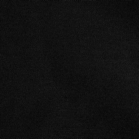 A Black 20 quot x 20 quot black hemmed polyspun cloth napkin 12 pack