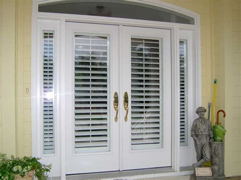 Exterior Doors With Built In Blinds Exterior Wood Doors Open Out With Built In Blinds And Narrow Side Windows Painted With