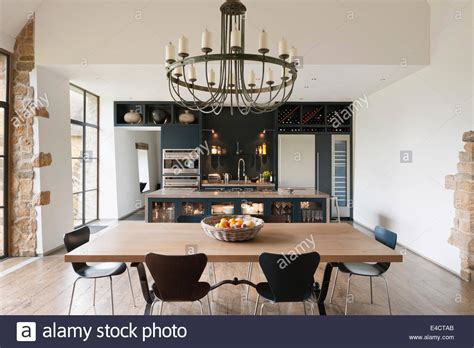 Kitchen Table Chandelier Verdigris Chandelier Hangs Above An Oak Topped Dining Table In Stock Photo Royalty Free Image