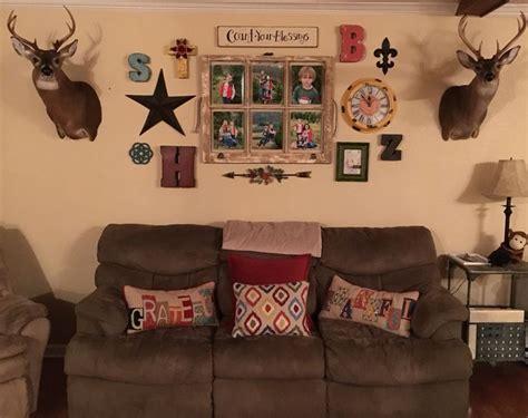 gallery wall window frame deer mount living room