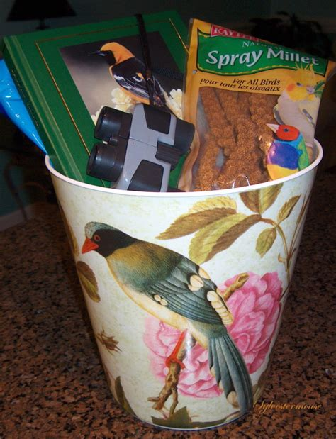 using a decorative trash can as a gift basket house of