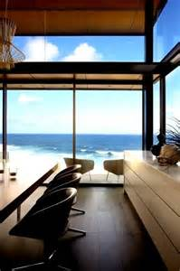 view interior of homes modern house with glass front and a wonderful sea