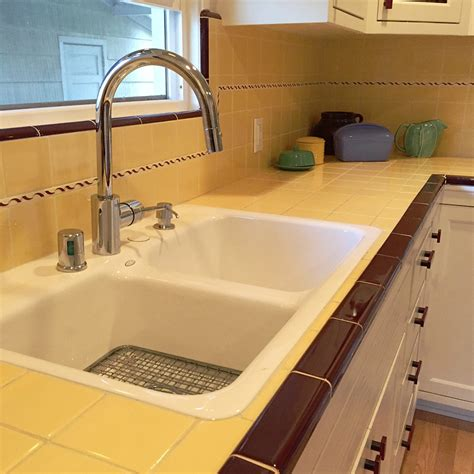 carolyn s gorgeous 1940s kitchen remodel featuring yellow tile with maroon trim retro renovation