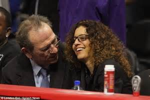 Tommy lee jones can t keep his eyes off wife dawn during basketball
