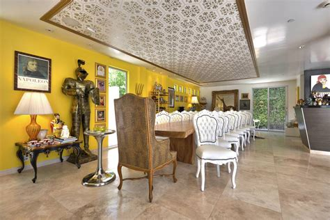 yellow accent wall eclectic dining room with yellow accent wall design