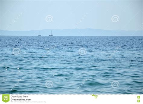 distances by boat two sailing boats in distance stock photo image 71053689