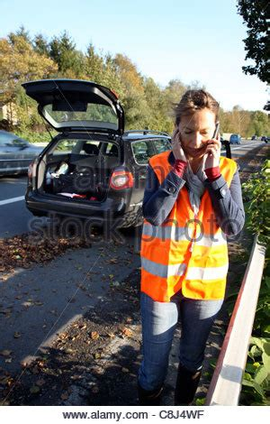 woman driver on the phone for car breakdown woman calling for car help stock photo royalty free image