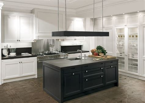 white kitchen island with black granite top white cabinets black island with white kitchen cabinet