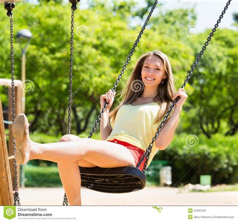 woman on a swing woman on swing in summer stock photo image 41991343