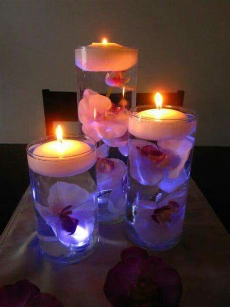 how to make a centerpiece with candles lit up trio of floating candle centerpieces bedazzlingly