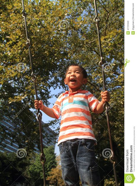 swing years japanese boy on a swing stock photo image 47731043
