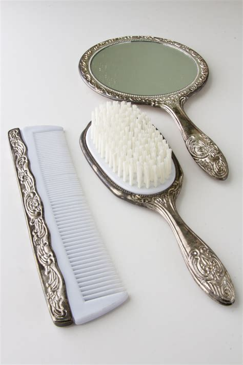 vintage silver vanity set with comb brush and mirror