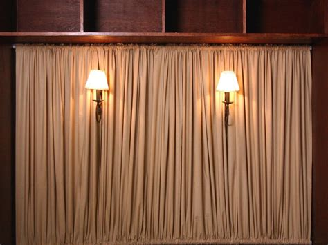 sconces for curtain rods create a curtained headboard with sconces hgtv