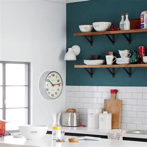 teal kitchen with a subway tile backsplash decoist