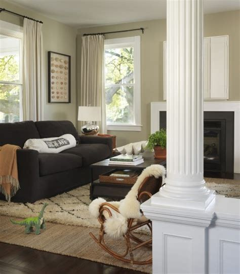 jute rug living room gray couch tan walls white accents black frames