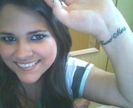 a bruno mars fan shows off her tattoo in honour of the