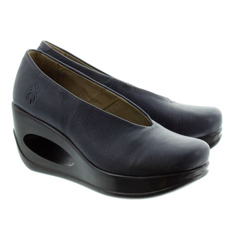fly hyaz wedge shoes in navy in navy