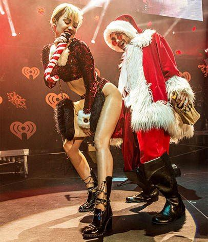 miley cyrus dressed as mrs claus at the jingle ball popsugar miley cyrus twerks on santa claus at 2013 jingle ball
